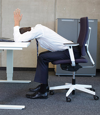 corporate wellness incorporates desk yoga for improved employee health